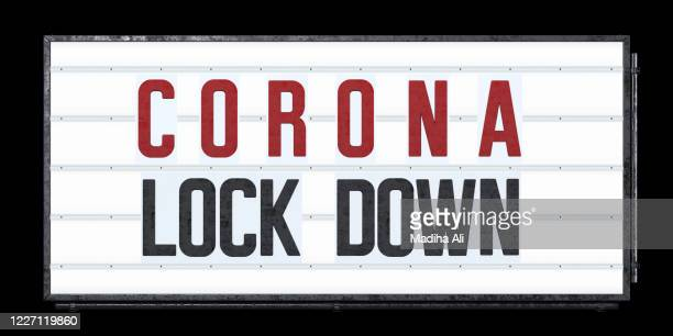 a marquee sign showing corona lock down outside a theatre - entertainment tent stock pictures, royalty-free photos & images