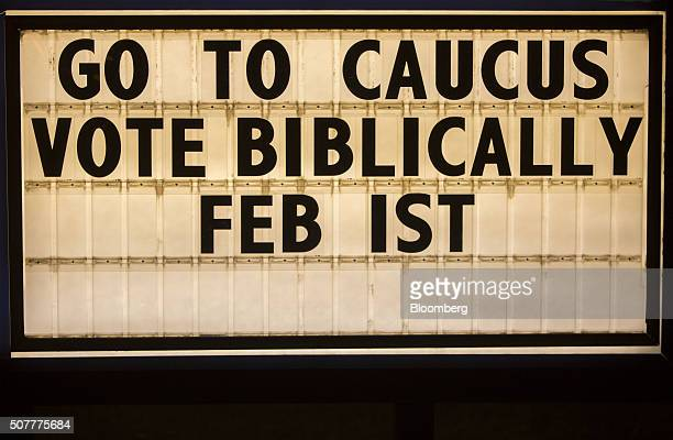 A marquee with the phrase Go To Caucus Vote Biblically is seen outside the Fort Des Moines Church of Christ during a Wednesday night service in Des...