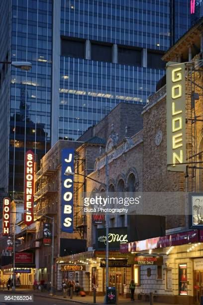 marquees of broadway theaters on west 45th street at dusk, in the theater district of broadway, manhattan, new york city - broadway manhattan stock pictures, royalty-free photos & images