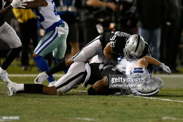 Marquel Lee and Xavier WoodsonLuster of the Oakland Raiders tackle Ryan Switzer of the Dallas Cowboys during their NFL game at OaklandAlameda County...