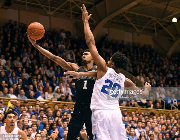 Marques Bolden of the Duke Blue Devils battles Ikenna Smart of the Wake Forest Demon Deacons for a rebound during the first half of their game at...