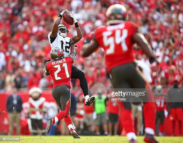 Marques Colston of the New Orleans Saints catches a pass for a first down as Alterraun Verner of the Tampa Bay Buccaneers defends during the second...