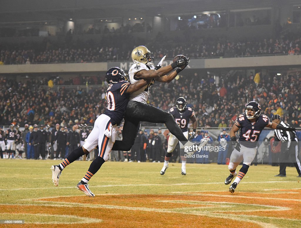 Marques Colston #12 of the New Orleans Saints catches a touchdown in front of Demontre Hurst #30 of the Chicago Bears during the second quarter on December 15, 2014 at Soldier Field in Chicago, Illinois.