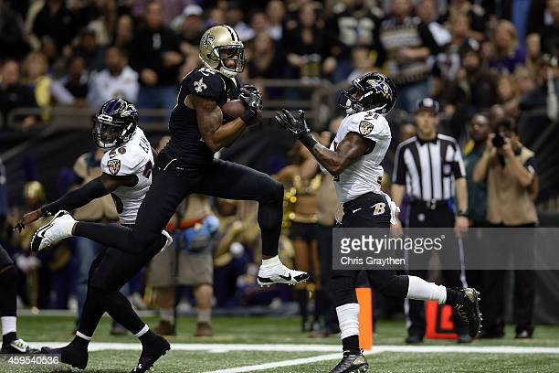 Marques Colston of the New Orleans Saints catches a touchdown pass in front of Terrence Brooks of the Baltimore Ravens during the second quarter of a...