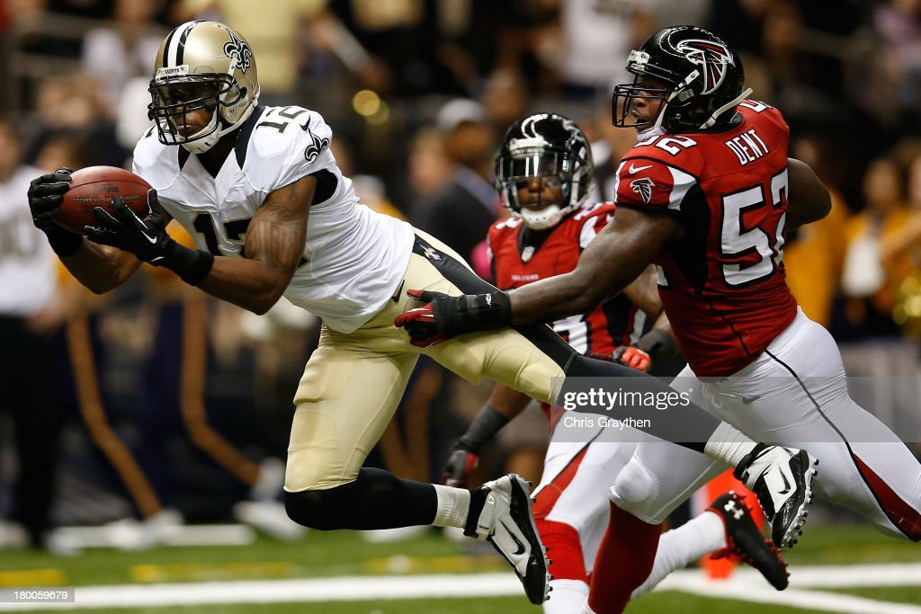 Marques Colston #12 of the New Orleans Saints catches a touchdown pass over Akeem Dent #52 of the Atlanta Falcons at the Mercedes-Benz Superdome on September 8, 2013 in New Orleans, Louisiana.