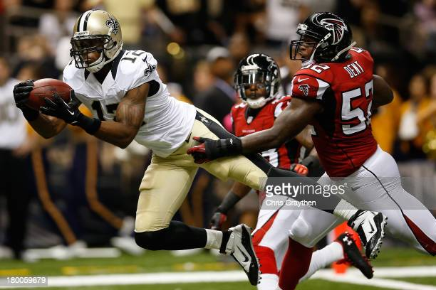 Marques Colston of the New Orleans Saints catches a touchdown pass over Akeem Dent of the Atlanta Falcons at the MercedesBenz Superdome on September...