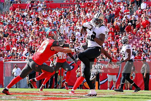 Marques Colston of the New Orleans Saints catches a touchdown pass during the first quarter of the game against the Tampa Bay Buccaneers at Raymond...