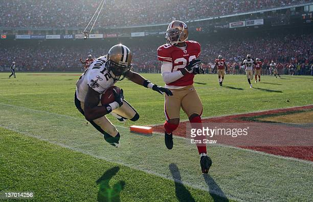 Marques Colston of the New Orleans Saints catches the ball for a touchdown in the second quarter against the San Francisco 49ers in the second...