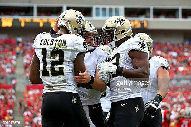 Marques Colston of the New Orleans Saints celebrates with Drew Brees after scoring a touchdown during the second quarter of the game against the...