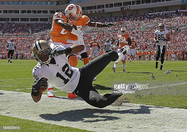 Marques Colston of the New Orleans Saints dives for a touchdown during a game against the Tampa Bay Buccaneers at Raymond James Stadium on October 21...
