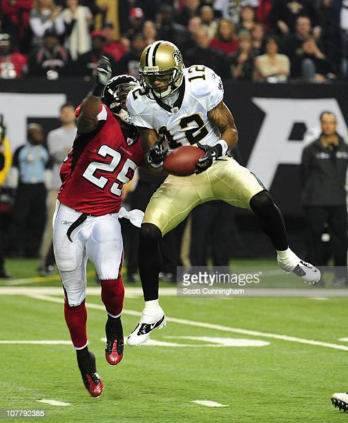 Marques Colston of the New Orleans Saints goes up for a catch against William Moore of the Atlanta Falcons at the Georgia Dome on December 27 2010 in...