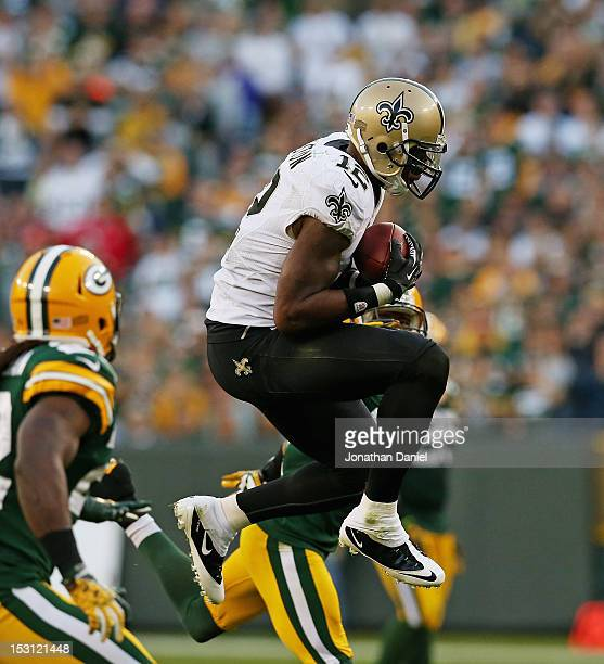 Marques Colston of the New Orleans Saints leaps to make a catch against the Green Bay Packers at Lambeau Field on September 30 2012 in Green Bay...