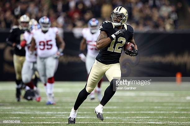 Marques Colston of the New Orleans Saints runs for a touchdown during the second quarter of a game against the New York Giants at the MercedesBenz...