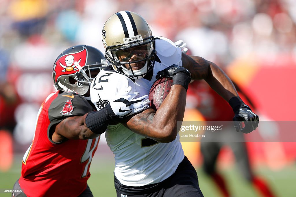 Marques Colston #12 of the New Orleans Saints runs upfield for extra yardage after a reception against the Tampa Bay Buccaneers during the first half of the game at Raymond James Stadium on December 28, 2014 in Tampa, Florida.