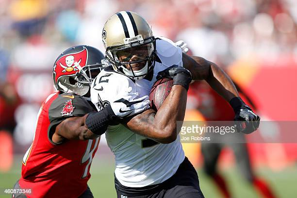 Marques Colston of the New Orleans Saints runs upfield for extra yardage after a reception against the Tampa Bay Buccaneers during the first half of...