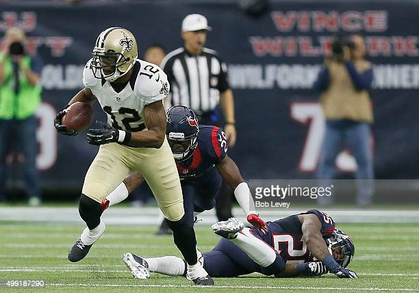 Marques Colston of the New Orleans Saints rushes past Andre Hal and Kareem Jackson of the Houston Texans in the second quarter on November 29 2015 at...