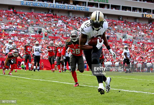 Marques Colston of the New Orleans Saints scores a touchdown during the second quarter of the game against the Tampa Bay Buccaneers at Raymond James...
