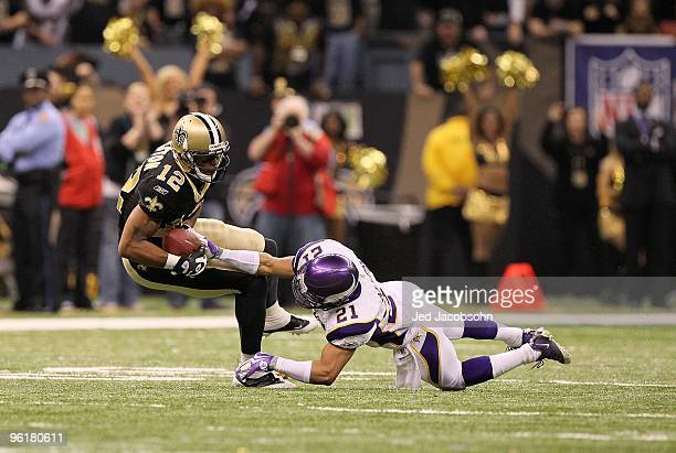 Marques Coltson of the New Orleans Saints makes a reception against Asher Allen of the Minnesota Vikings during the NFC Championship Game at the...