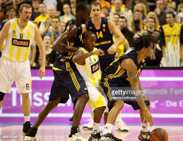 Marques Green #4 of Fenerbahce Ulker surrounded by Ansu Sesay #9 of Alba Berlin and Rashad Wright #12 of Alba Berlin in action during the Euroleague...