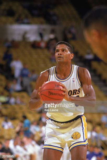 Marques Johnson of the Golden State Warriors looks to make a free throw during an NBA game in the 198990 season NOTE TO USER User expressly...