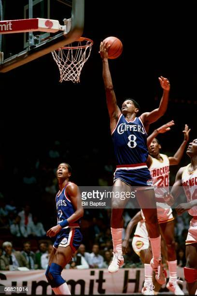 Marques Johnson of the Los Angeles Clippers goes up for a shot against the Houston Rockets circa 1985 at The Summit in Houston Texas NOTE TO USER...