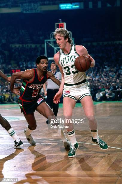 Marques Johnson of the Milwaukee Bucks defends against Larry Bird of the Boston Celtics during a game played in 1981 at the Boston Garden in Boston...