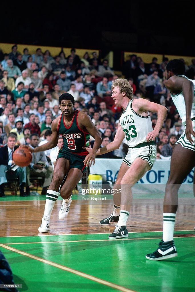 Marques Johnson #8 of the Milwaukee Bucks drives to the basket against Larry Bird #33 of the Boston Celtics during a game played in 1983 at the Boston Garden in Boston, Massachusetts.