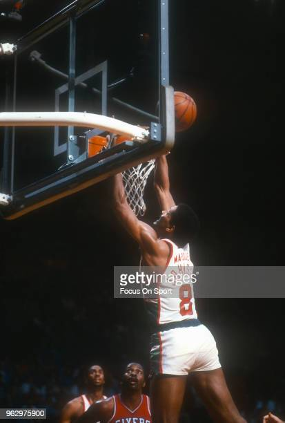 Marques Johnson of the Milwaukee Bucks goes up for a layup against the Philadelphia 76ers during an NBA basketball game circa 1982 at the MECCA Arena...