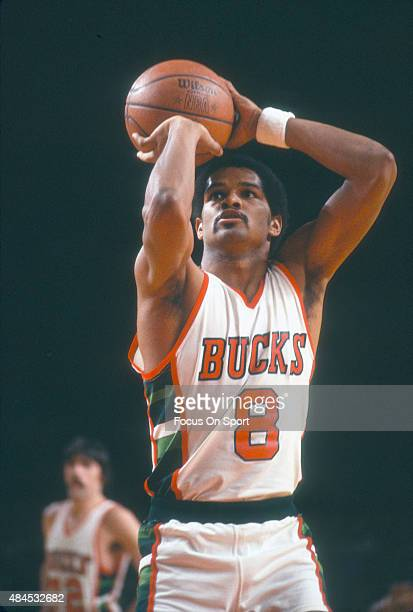 Marques Johnson of the Milwaukee Bucks shoots a free throw during an NBA basketball game circa 1980 at the MECCA Arena in Milwaukee Wisconsin Johnson...