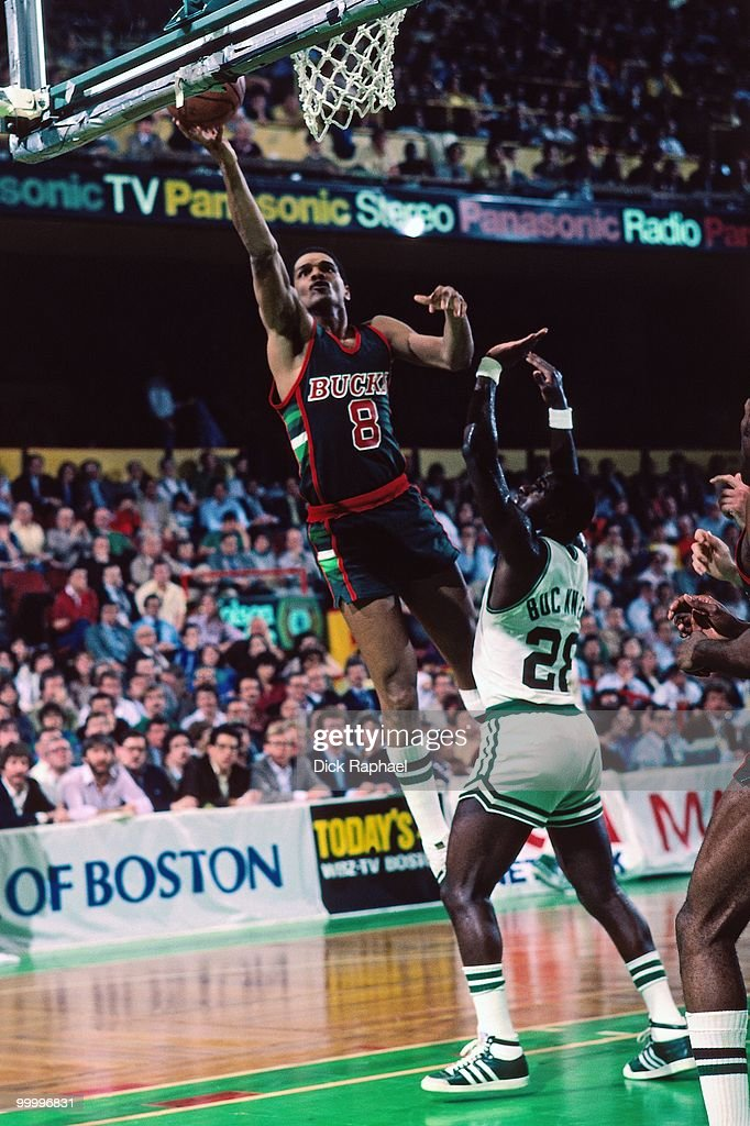 Marques Johnson #8 of the Milwaukee Bucks shoots a layup against Quinn Buckner #28 of the Boston Celtics during a game played in 1983 at the Boston Garden in Boston, Massachusetts.