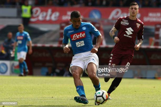 Marques Loureiro Allan vies Daniele Baselli during the Italian Serie A football SSC Napoli v Torino FC at S Paolo Stadium in Naples on May 6 2018