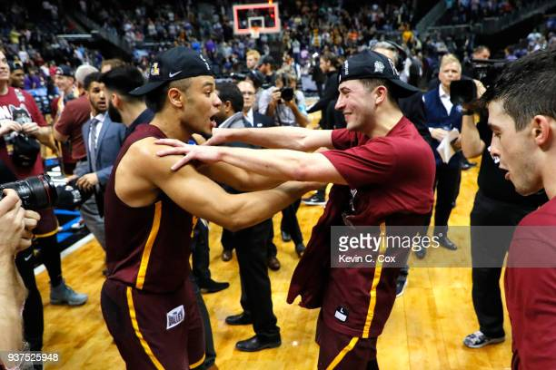 Marques Townes and Ben Richardson of the Loyola Ramblers celebrate after defeating the Kansas State Wildcats during the 2018 NCAA Men's Basketball...
