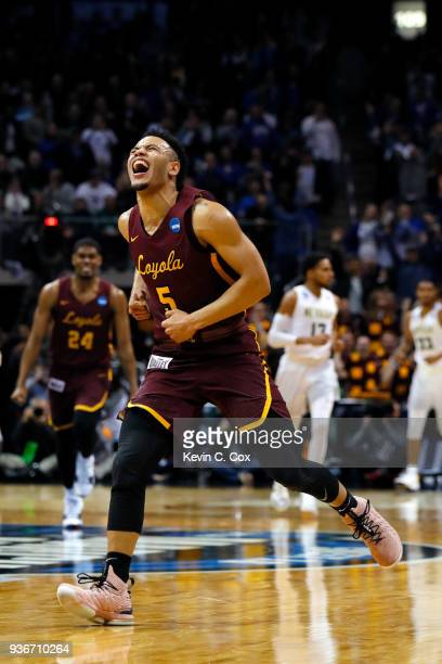 Marques Townes of the Loyola Ramblers celebrates his teams 6968 win over the Nevada Wolf Pack during the 2018 NCAA Men's Basketball Tournament South...