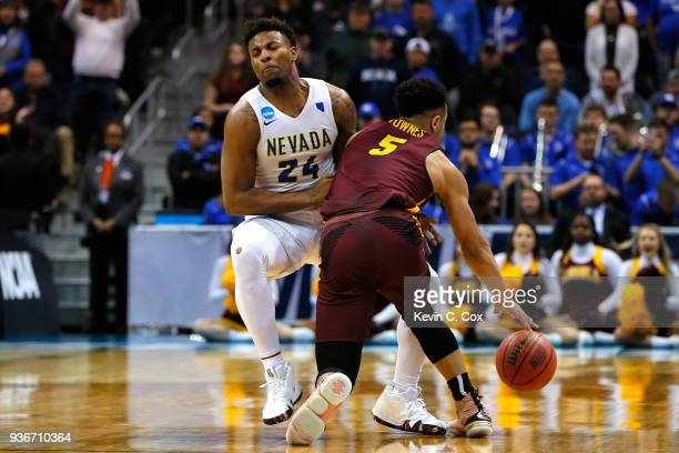Marques Townes of the Loyola Ramblers collides with Jordan Caroline of the Nevada Wolf Pack late in the second half during the 2018 NCAA Men's...