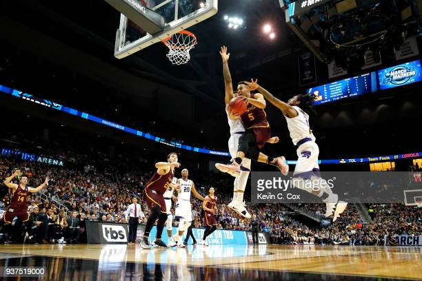 Marques Townes of the Loyola Ramblers drives to the basket against Cartier Diarra of the Kansas State Wildcats in the second half during the 2018...