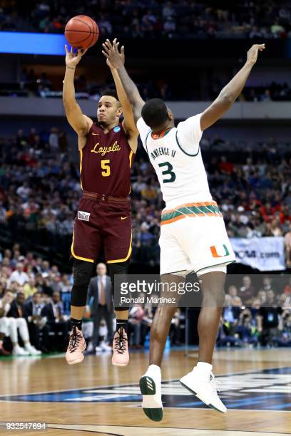 Marques Townes of the Loyola Ramblers shoots over Anthony Lawrence II of the Miami Hurricanes inthe second half in the first round of the 2018 NCAA...