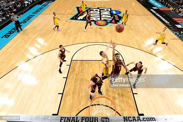 Marques Townes of the Loyola Ramblers shoots the ball against Duncan Robinson of the Michigan Wolverines during the first half in the 2018 NCAA...