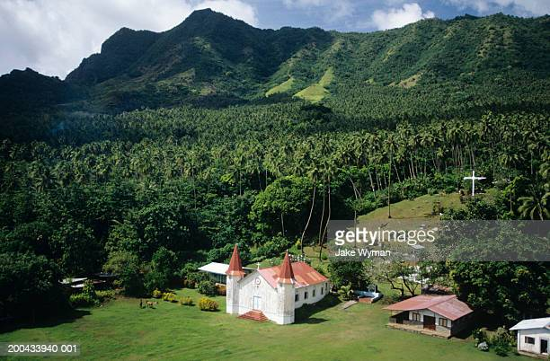 Marquesas, Nuku Hiva, church and cemetery, elevated view