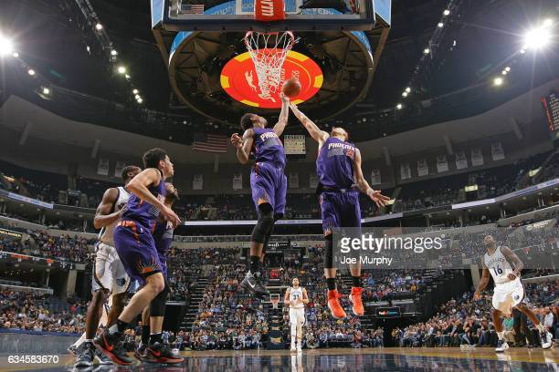 Marquese Chriss and Alex Len of the Phoenix Suns go up for a rebound against the Memphis Grizzlies on February 8 2017 at FedExForum in Memphis...