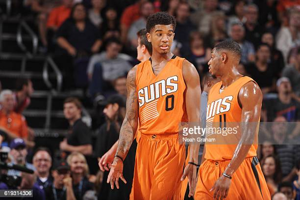 Marquese Chriss and Brandon Knight of the Phoenix Suns talk things over during the game against the Golden State Warriors on October 30 2016 at...