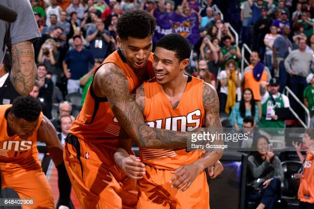 Marquese Chriss hugs Tyler Ulis of the Phoenix Suns after the game celebrating their victory against the Boston Celtics on March 5 2017 at US Airways...