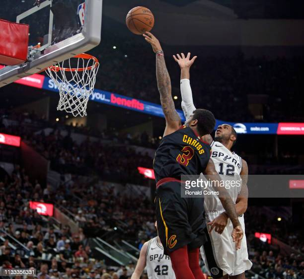 Marquese Chriss of the Cleveland Cavaliers scores past LaMarcus Aldridge of the San Antonio Spursat ATT Center on March 28 2019 in San Antonio Texas...