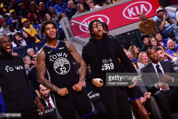 Marquese Chriss of the Golden State Warriors and D'Angelo Russell of the Golden State Warriors react during a game against the Chicago Bulls on...