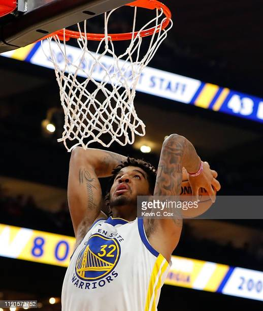 Marquese Chriss of the Golden State Warriors dunks against the Atlanta Hawks in the first half at State Farm Arena on December 02 2019 in Atlanta...