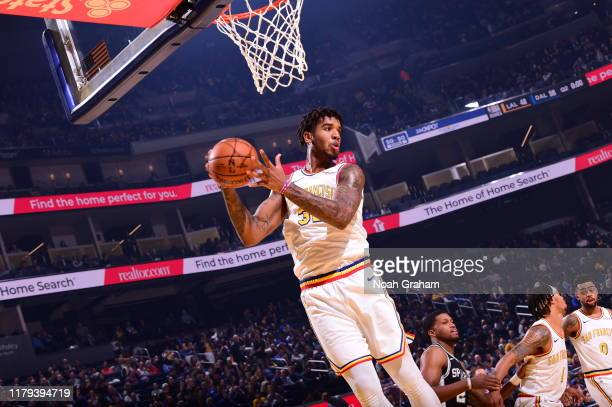 Marquese Chriss of the Golden State Warriors grabs the rebound against the San Antonio Spurs on November 1 2019 at Chase Center in San Francisco...