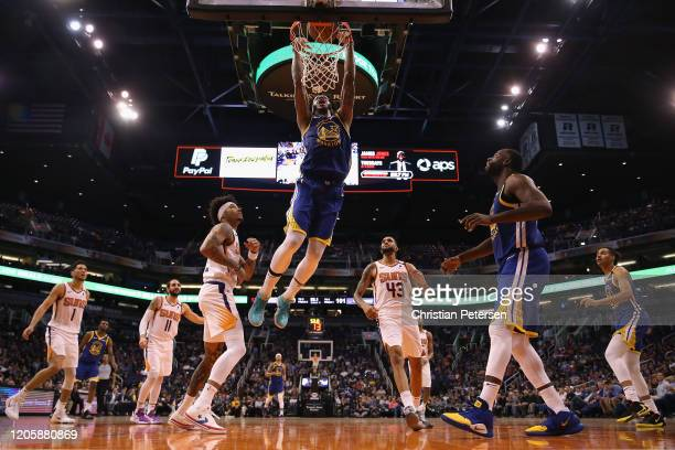 Marquese Chriss of the Golden State Warriors slam dunks the ball ahead of Kelly Oubre Jr #3 of the Phoenix Suns during the second half of the NBA...
