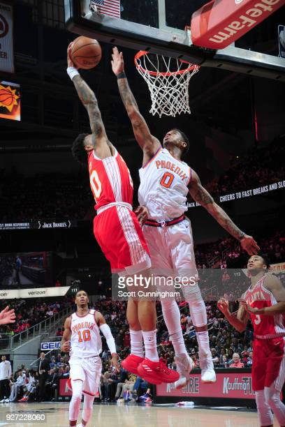 Marquese Chriss of the Phoenix Suns attempts to block the shot by John Collins of the Atlanta Hawks during the game on March 4 2018 at Philips Arena...