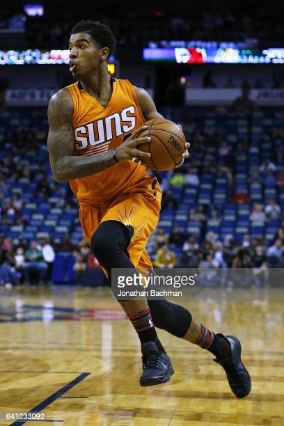 Marquese Chriss of the Phoenix Suns drives with the ball during the first half of a game against the New Orleans Pelicans at the Smoothie King Center...