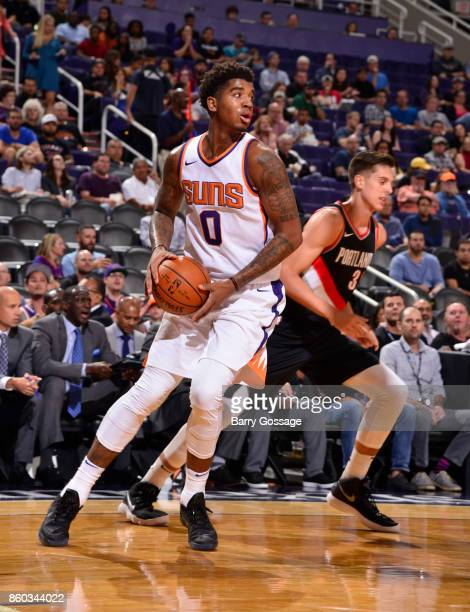 Marquese Chriss of the Phoenix Suns handles the ball against the Portland Trail Blazers during the preseason game on October 11 2017 at Talking Stick...