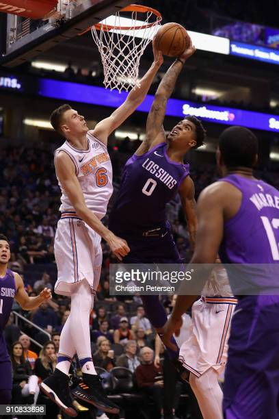 Marquese Chriss of the Phoenix Suns is blocked as he attempts a slam dunk against Kristaps Porzingis of the New York Knicks during the second half of...